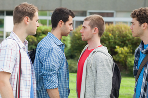 Two males students facing off before a fight on campusの写真素材 [FYI02233796]