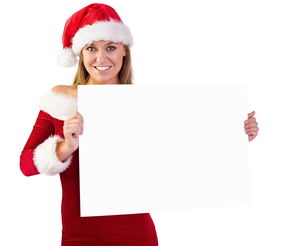 Festive blonde smiling at camera holding posterの写真素材 [FYI02233813]