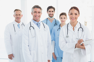 Smiling doctors all standing togetherの写真素材 [FYI02233961]