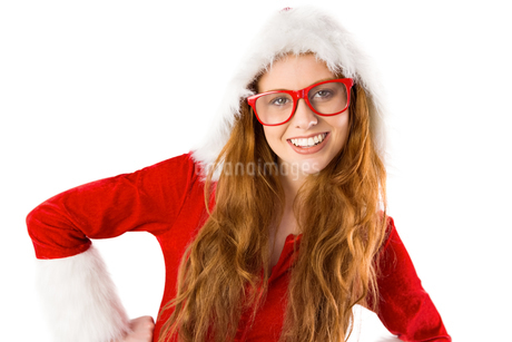 Festive redhead smiling at cameraの写真素材 [FYI02234149]