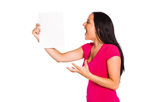 Angry woman shouting at piece of paperの写真素材 [FYI02234196]