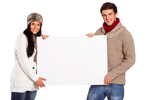 Young couple holding a posterの写真素材 [FYI02234405]