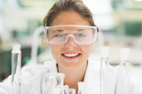 Attractive smiling student wearing safety glassesの写真素材 [FYI02234506]