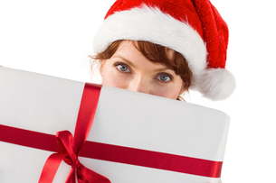Woman holding a christmas presentの写真素材 [FYI02234523]