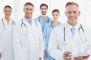 Smiling doctors all standing togetherの写真素材 [FYI02234641]
