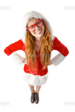 Festive redhead smiling at cameraの写真素材 [FYI02234850]