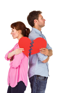 Couple holding a broken heartの写真素材 [FYI02234893]