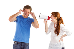 Woman shouting through a megaphoneの写真素材 [FYI02234916]