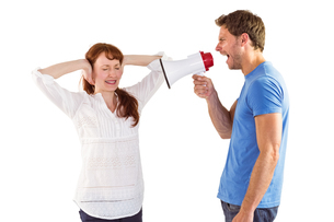 Man shouting through a megaphoneの写真素材 [FYI02234946]