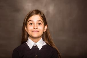 Cute pupil smiling at cameraの写真素材 [FYI02235073]