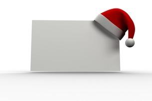 Red santa hat hanging on posterのイラスト素材 [FYI02235123]