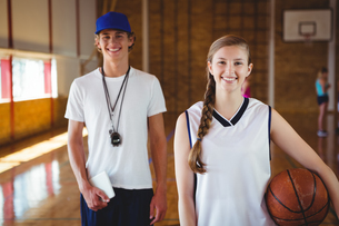 Portrait of smiling basketball player with male coachの写真素材 [FYI02235327]