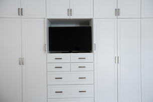 Empty wardrobe with television in living roomの写真素材 [FYI02235643]