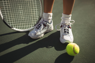 Low section of girl with racket and tennis balの写真素材 [FYI02235862]