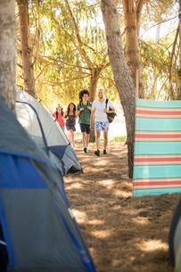 Friends with backpack walking at campsiteの写真素材 [FYI02236150]