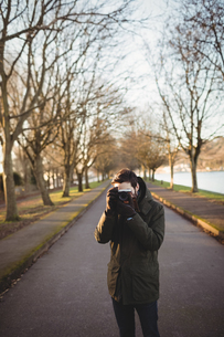 Man taking pictures from cameraの写真素材 [FYI02236171]