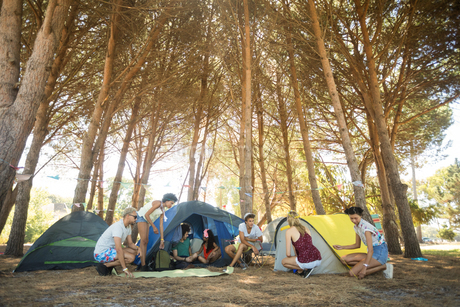 Friends camping at campsiteの写真素材 [FYI02236685]
