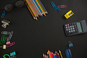 Various school supplies and apple arranged on black backgroundの写真素材 [FYI02236794]