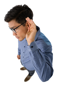 High angle view of businessman cupping earsの写真素材 [FYI02236866]
