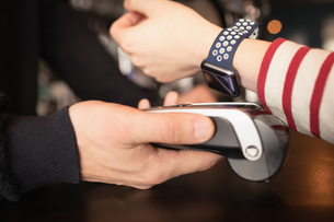 Woman paying through smartwatch using NFC technologyの写真素材 [FYI02236930]
