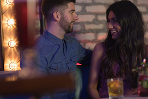 Couple talking while enjoying the drinks in barの写真素材 [FYI02236953]