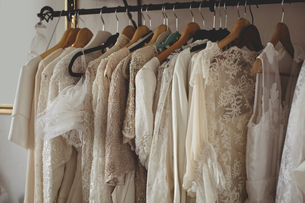 Variety of wedding dresses in wardrobeの写真素材 [FYI02237009]