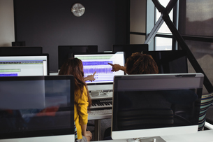Audio engineers using sound mixerの写真素材 [FYI02237315]