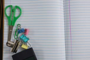 Various school supplies on notebookの写真素材 [FYI02237489]
