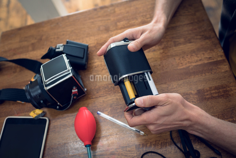 Cropped image of photographer removing reelの写真素材 [FYI02238621]