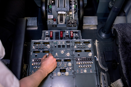 High angle view of pilot switching control in cockpitの写真素材 [FYI02238839]