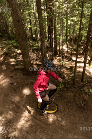 High angle view of woman unicycling on trailの写真素材 [FYI02239112]
