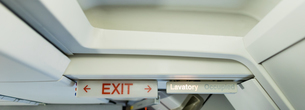 Exit sign board in aircraftの写真素材 [FYI02239772]