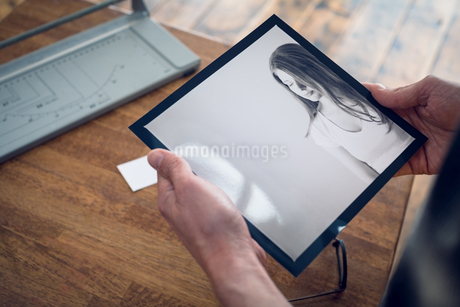 Cropped image of photographer holding photographの写真素材 [FYI02240122]
