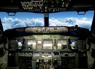 Clouds seen from airplane windshieldの写真素材 [FYI02240368]