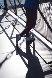 Low section of woman standing on bridgeの写真素材 [FYI02240662]