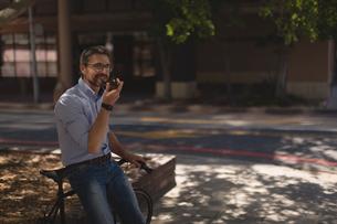 Man talking on mobile phone near streetの写真素材 [FYI02242211]
