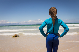 Rear view of girl looking at her sister while surfingの写真素材 [FYI02242986]