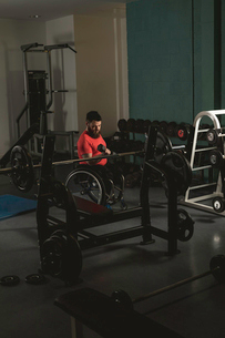 Handicapped man on wheelchair working out with dumbbellの写真素材 [FYI02245140]