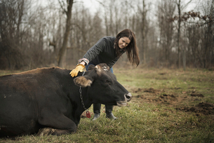 Farmer working and tending to the animals on an organic farmの写真素材 [FYI02245180]
