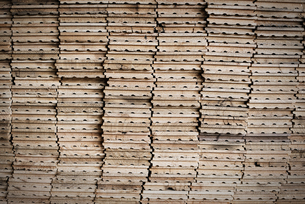 Stacks of reclaimed, cleaned up planks of wood for re-use.の写真素材 [FYI02246660]