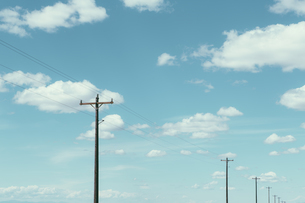 Telephone poles, power lines and cloudy sky, near Quincyの写真素材 [FYI02246887]