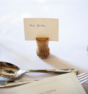 Close up of a place setting on the top table at a wedding banquet. An upside down cork with a name tの写真素材 [FYI02246966]
