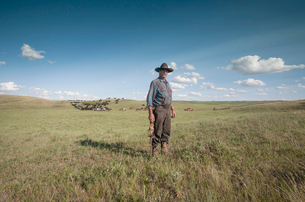 Spring roundup. A working cowboy on the plain. A herd of cattle.の写真素材 [FYI02248525]