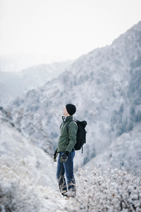 A man hiking through the mountains carrying a rucksack.の写真素材 [FYI02248832]