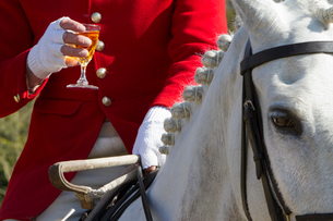 A Master of Foxhounds having a drink at a hunt meet.の写真素材 [FYI02248950]