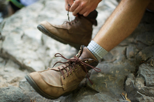 A man taking his boots offの写真素材 [FYI02249390]