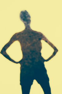 The outline of a human body, a shadow against a plain background.の写真素材 [FYI02251146]