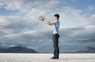 A teenage boy holding a molecular structure in his hands.の写真素材 [FYI02251912]