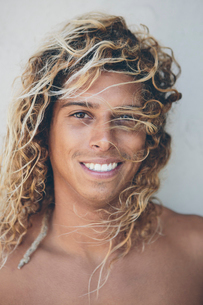 Portrait of young Hispanic surfer with bleached blonde hair.の写真素材 [FYI02252203]