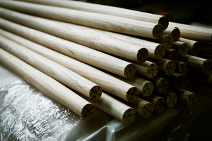 A heap of round smooth wooden poles or components of a wooden chair.の写真素材 [FYI02252230]